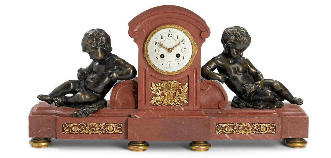 A Tiffany & Co. Gilt Bronze and Rouge Marble Clock
