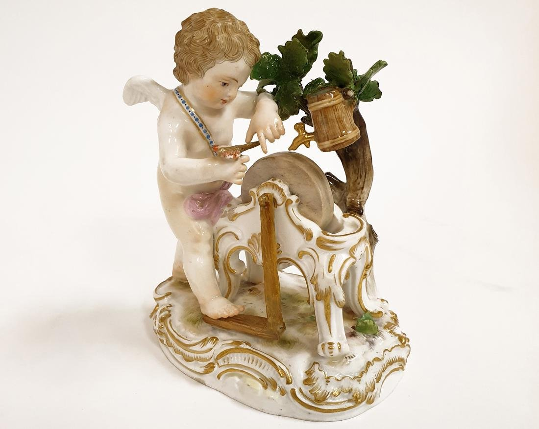 A Meissen Porcelain Putto Figurine