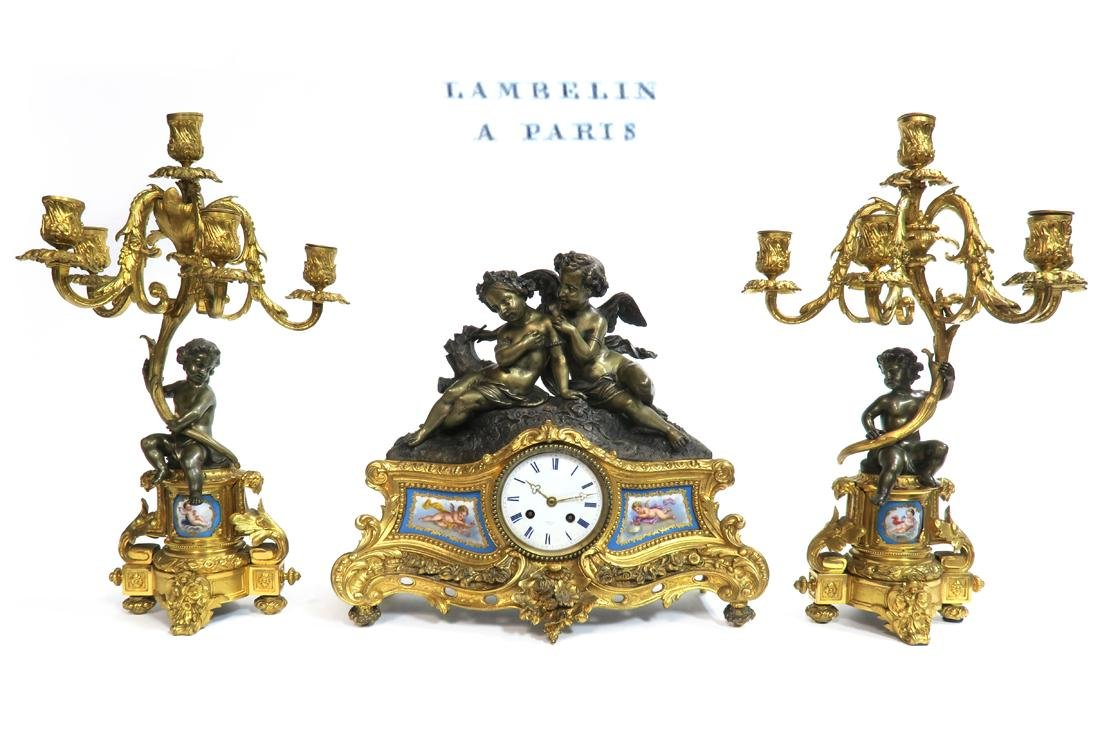 A French Sevres Figural Bronze Clock set, 19th C.
