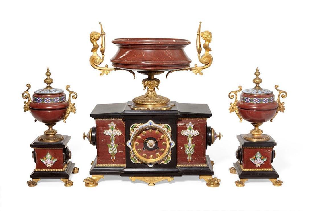 A GILT BRONZE & CHAMPELVE ENAMEL CLOCK GARNITURE SET