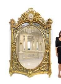 19th C. Monumental Figural Giltwood Mirror