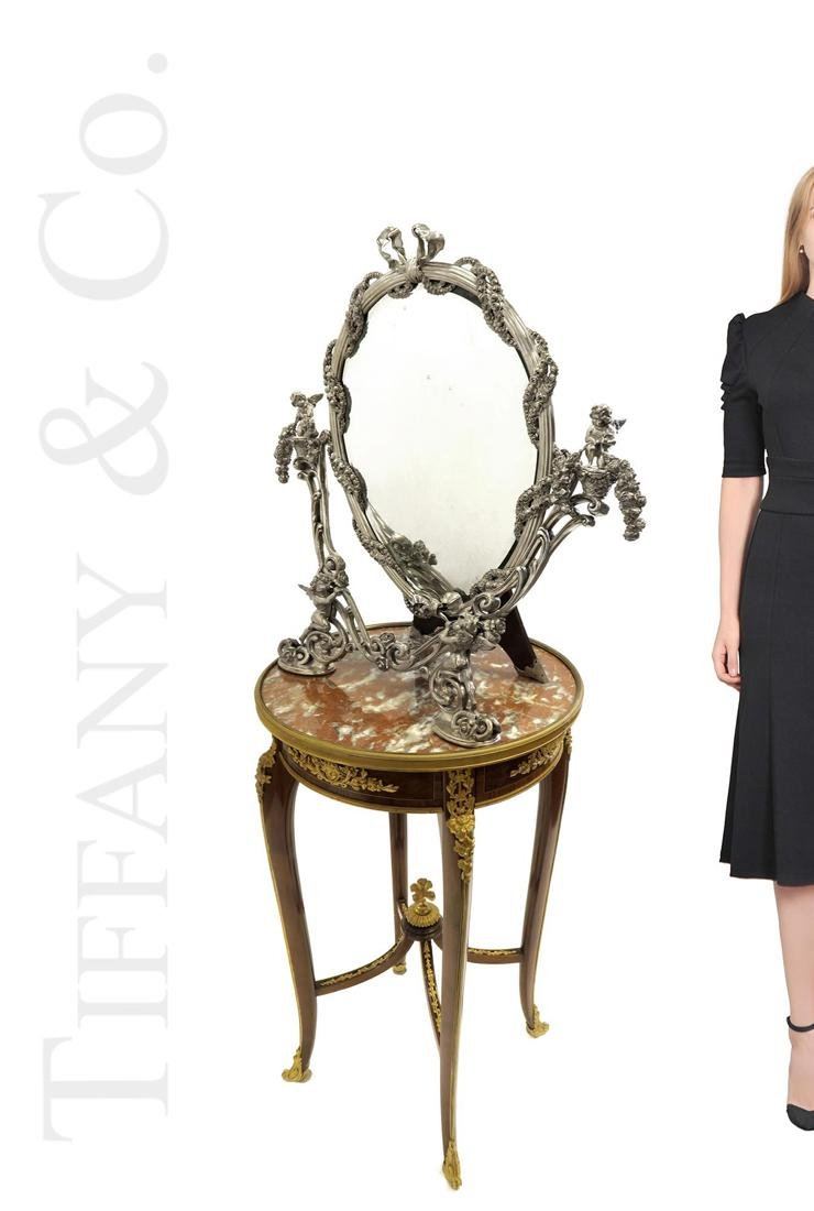 A Large Tiffany & Co. Sterling Silver Figural Mirror