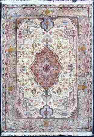 A Persian Tabriz silk & wool rug