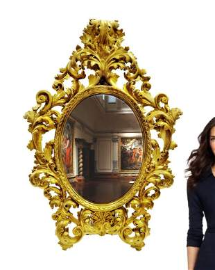 A LARGE GILTWOOD ROCOCO STYLE MIRROR, LATE 19TH CENTURY