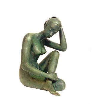 A SEATED NUDE FEMALE BRONZE SCULPTURE