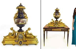 A Large Figural Gilt Bronze Sevres Jeweled Cobalt Clock