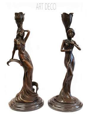 A Pair of Bronze Figural Candle Holders, Milo Signed