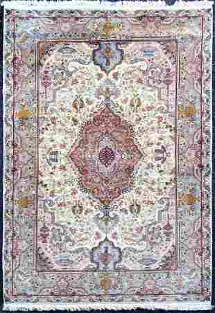 A Persian Tabriz silk & wool rug
