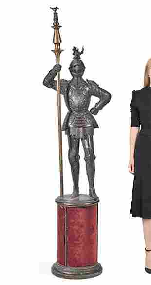 A PATINATED BRONZE FIGURE OF AN ARMOURED KNIGHT