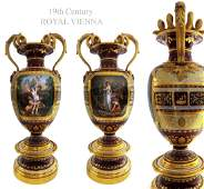 A PAIR OF 19TH C. ROYAL VIENNA PARCEL-GILT VASES