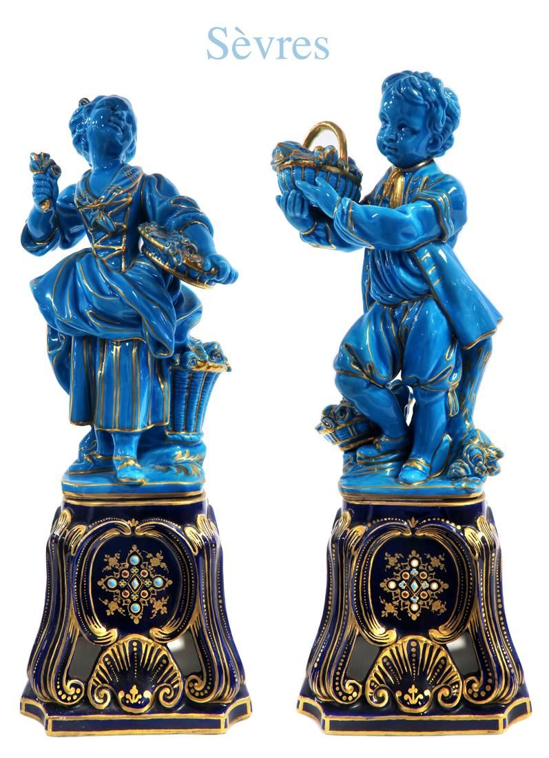 A PAIR OF 19TH CENTURY SEVRES TURQUOISE GLAZE FIGURES