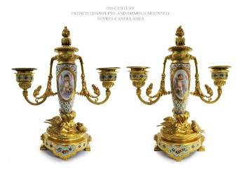 A Pair of Champleve Sevres Figural Bronze Candelabras