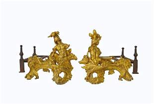 AN IMPORTANT PAIR OF FRENCH LOUIS XV ORMOLU CHENETS