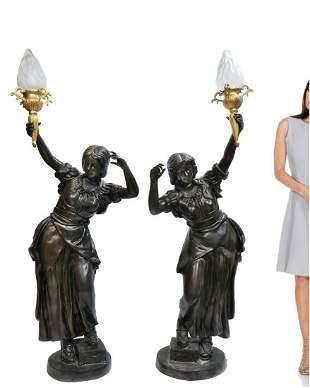 A PAIR OF ART DECO BRONZE FIGURAL TORCHERE LAMPS