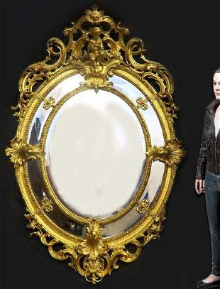 A Monumental French Hand Curved Wood Figural Mirror