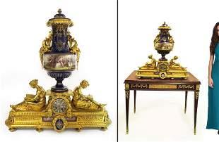A Large Figural Gilt Bronze Sevres Jeweled Cobalt Clock