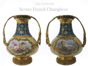 A PAIR OF CHAMPLEVE ENAMEL BRONZE & SEVRES VASES