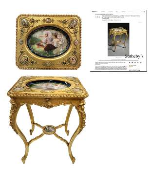 A ROYAL VIENNA CARVED GILTWOOD BRONZE PLAUQES TABLE