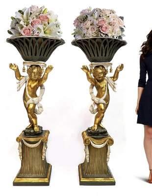 A Pair of Monumental Carved Wood Figural Jardinieres