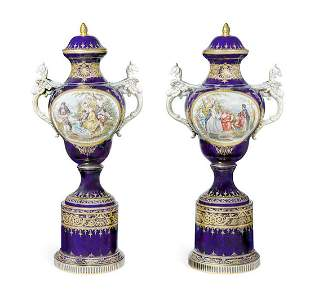 PAIR OF VIENNA STYLE COVERED VASES ON SEPARATE PEDESTAL