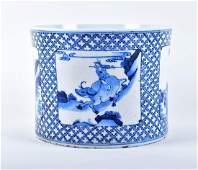 A Qing dynasty blue and white porcelain jardiniere of