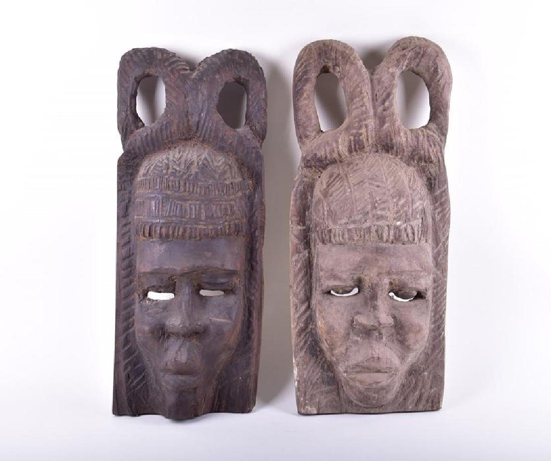 A large pair of decorative central African carved