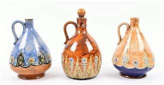Three Royal Doulton stoneware flagons or whisky
