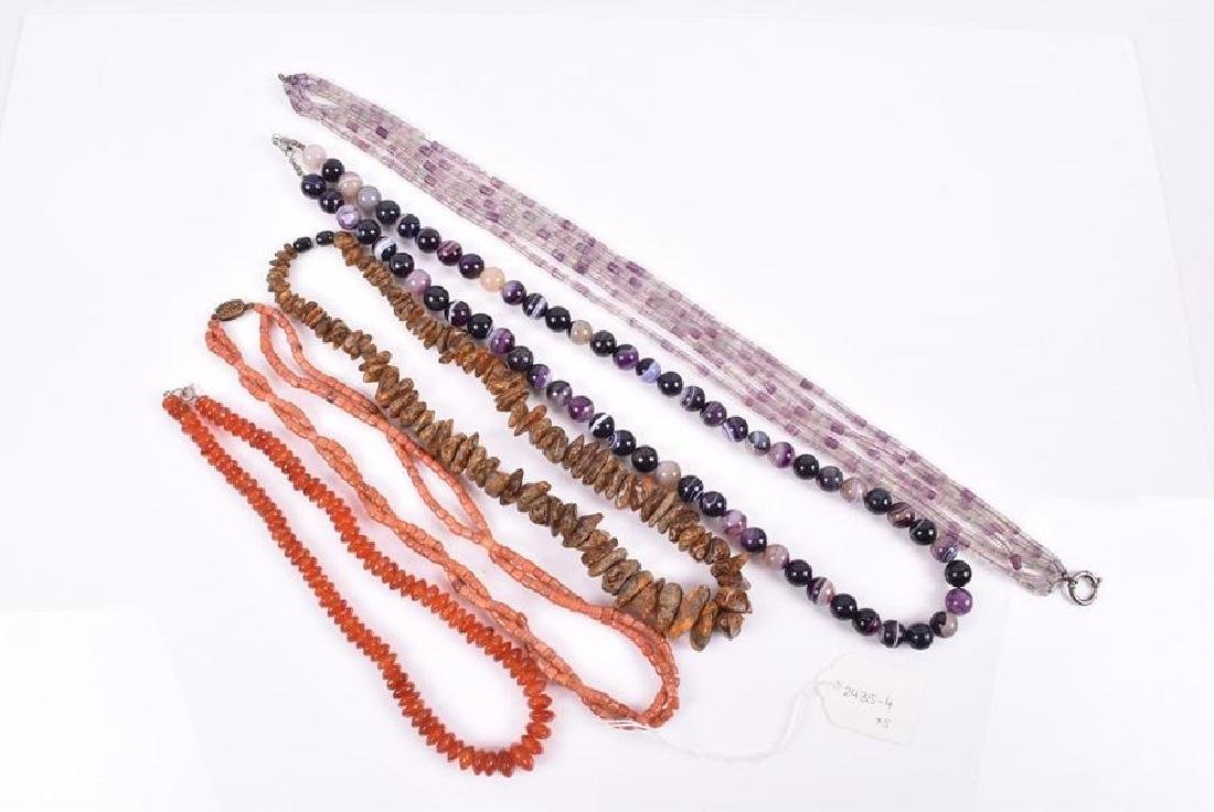 A long purple agate beaded necklace together with an - 2