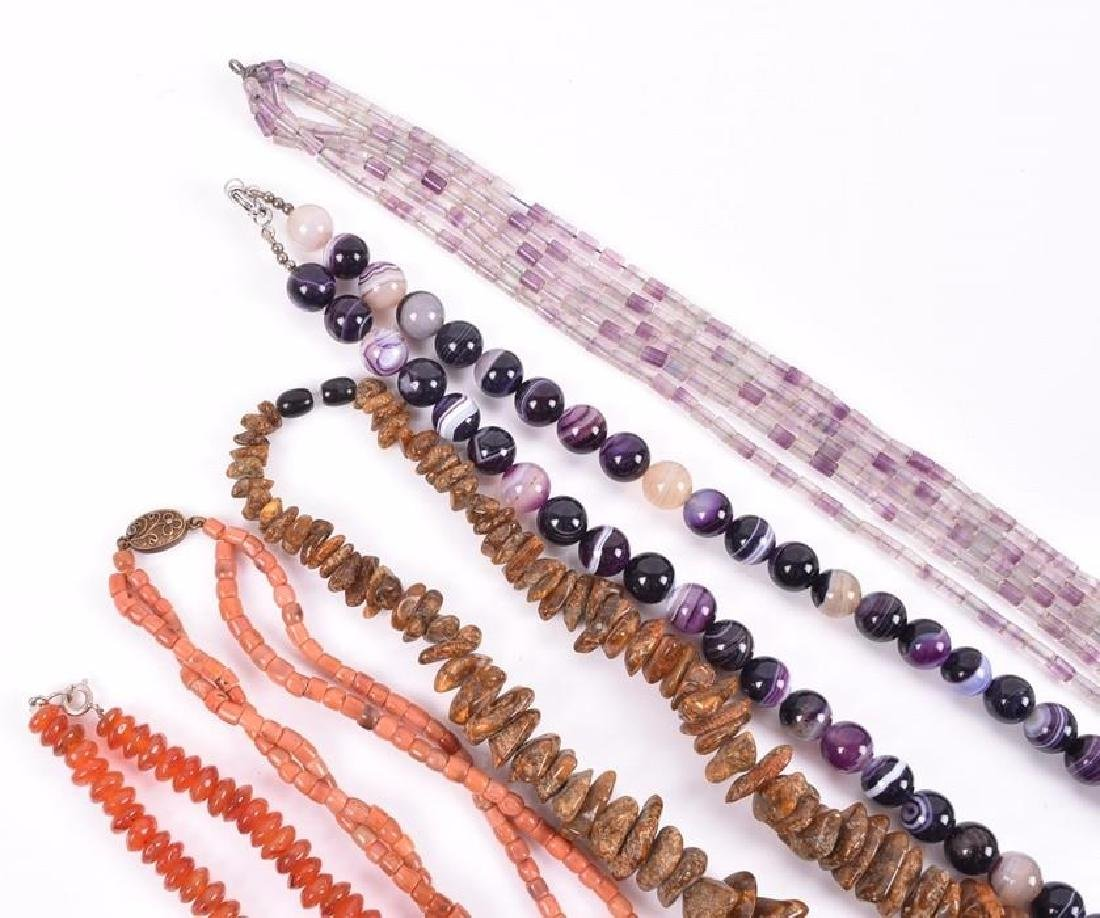 A long purple agate beaded necklace together with an - 3