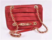 Moschino vinyl handbag in orange red  the vinyl folded
