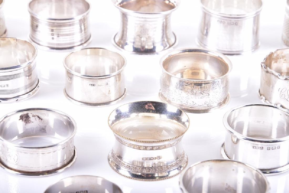 A collection of assorted sterling silver napkin rings - 2
