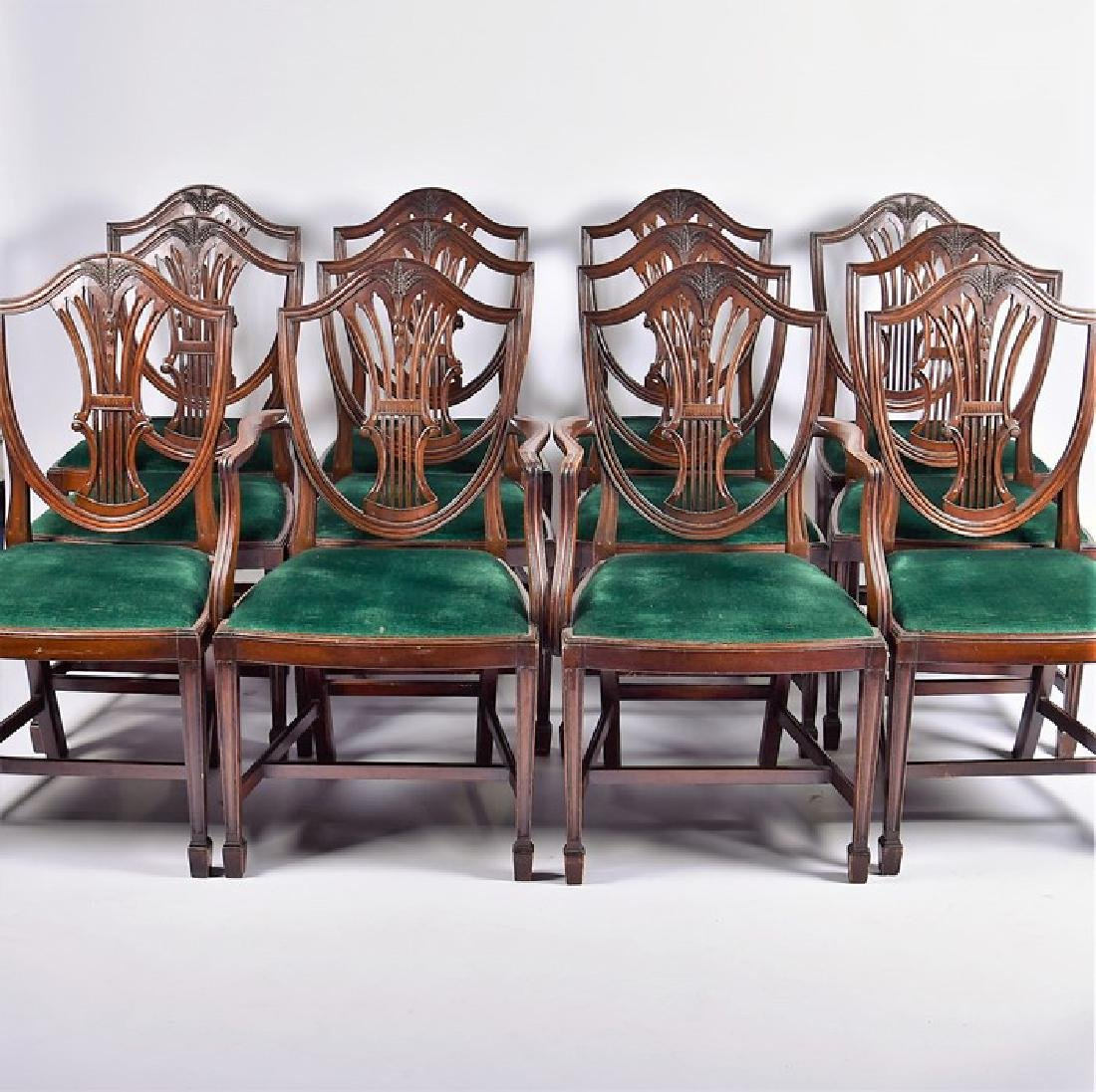A set of twelve Sheraton style mahogany dining chairs