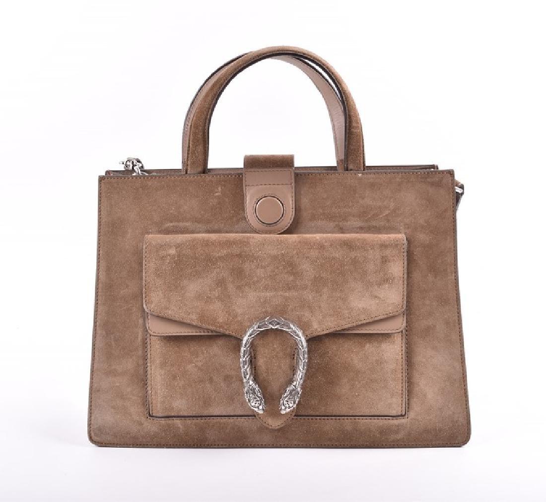 Gucci. A green suede satchel style handbag  of