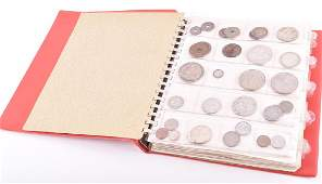 An album containing a quantity of collectors coins  to