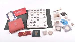 An album containing a quantity of collectors coins