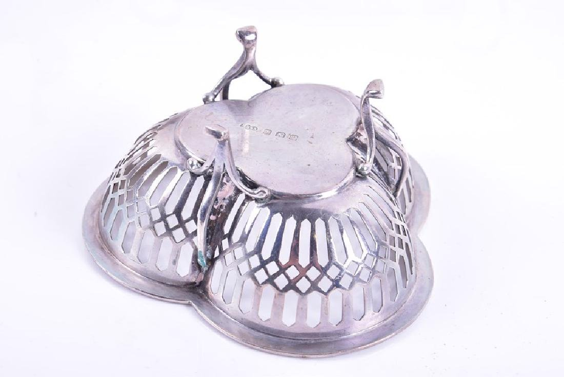 A group of assorted items of silver  including a three - 9