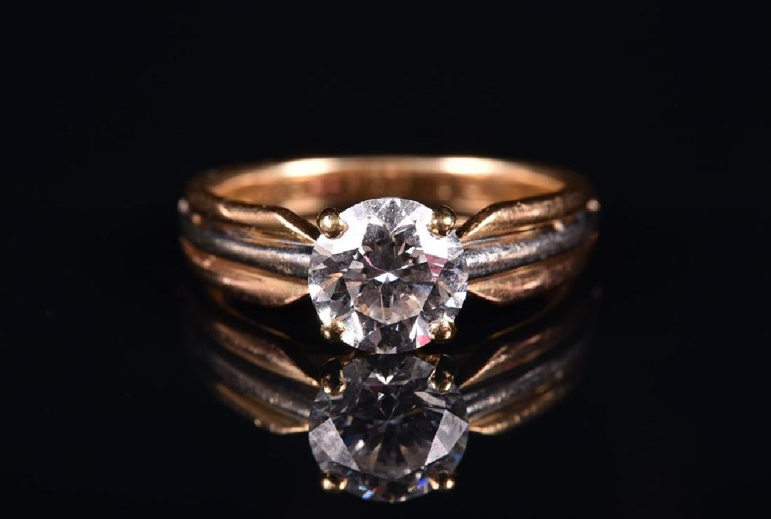 Cartier. A solitaire diamond ring   set with a - 2