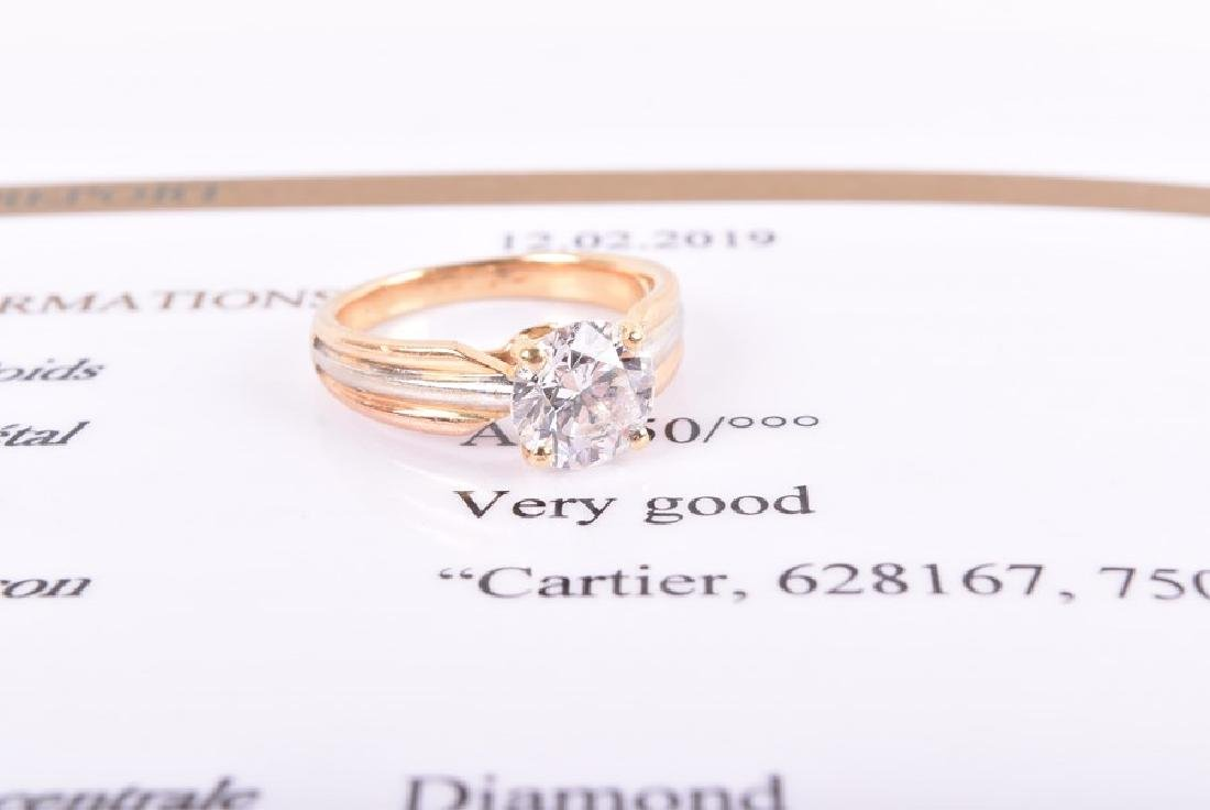 Cartier. A solitaire diamond ring   set with a - 5