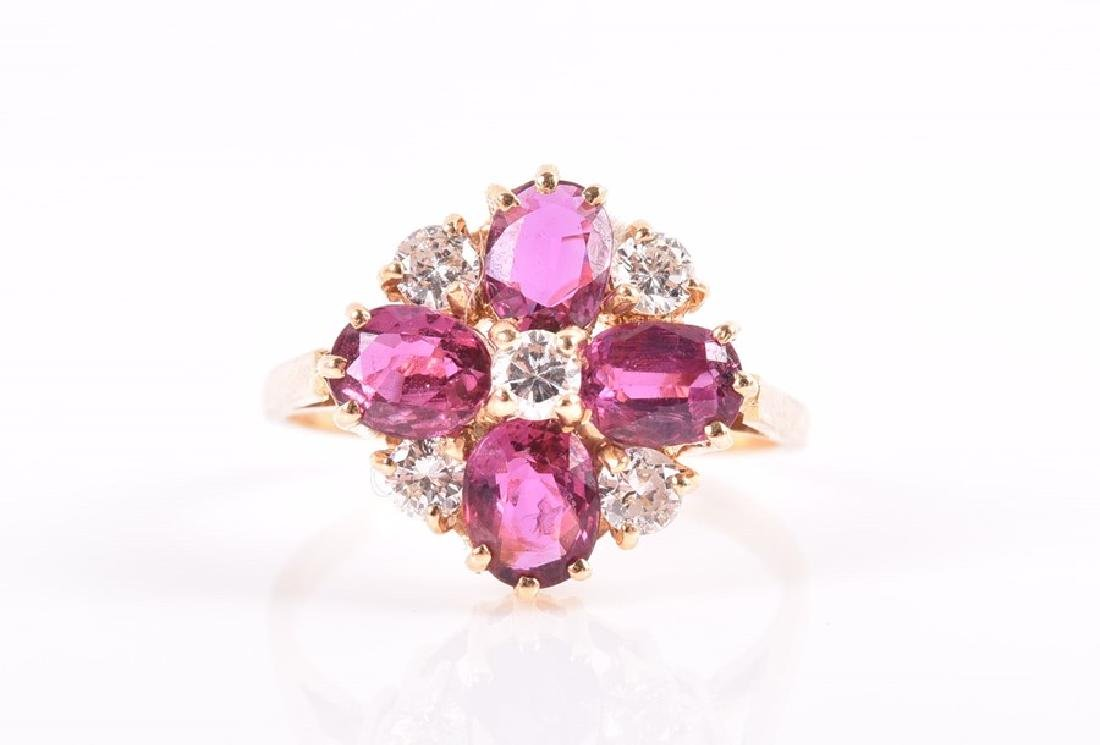 A tourmaline and diamond quatrefoil cluster ring  set