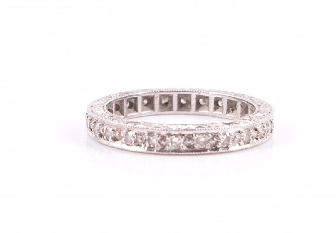 A diamond eternity ring  set with diamond accents, the