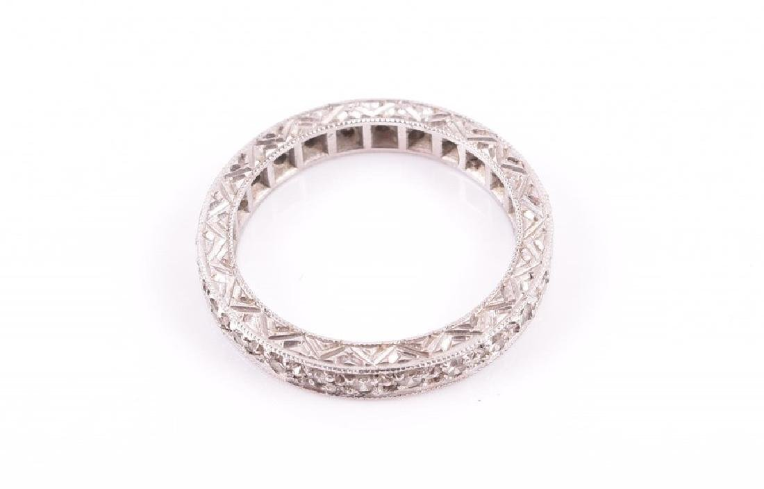A diamond eternity ring  set with diamond accents, the - 2