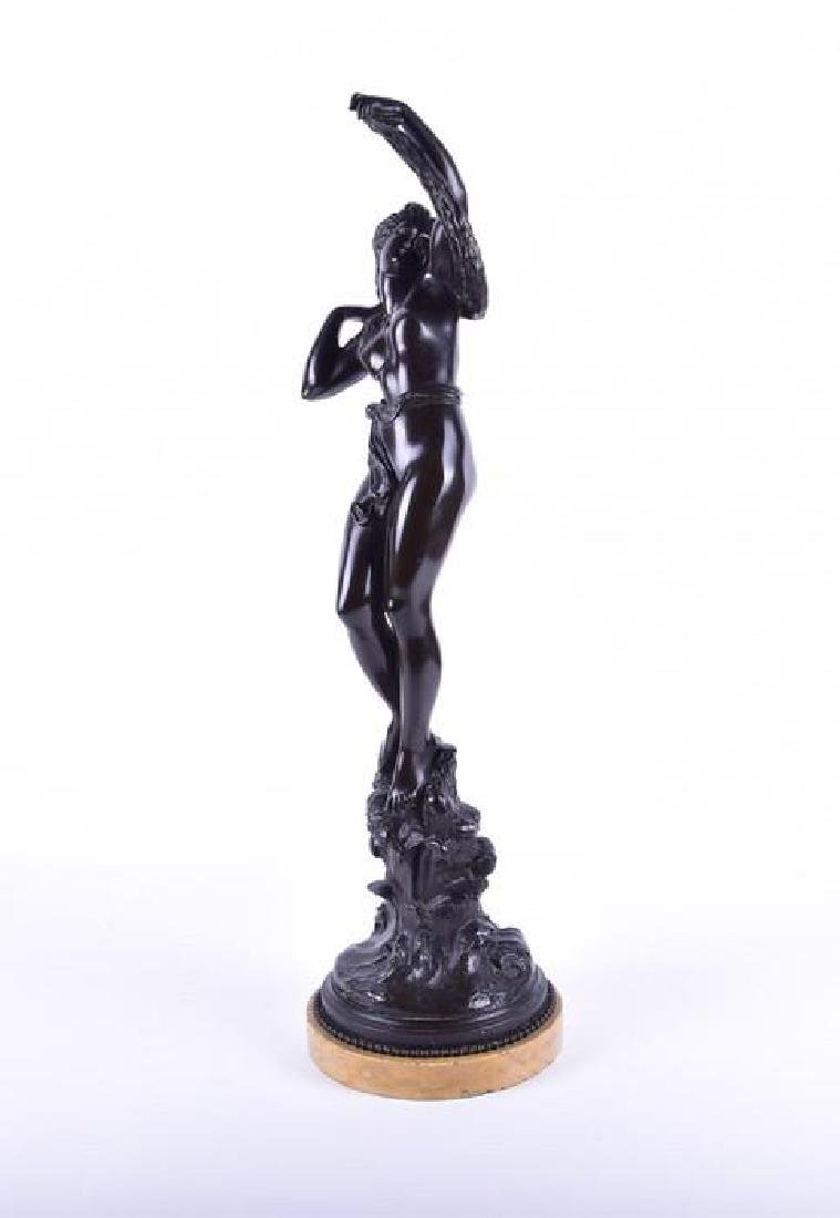 A late 19th/early 20th century patinated bronze