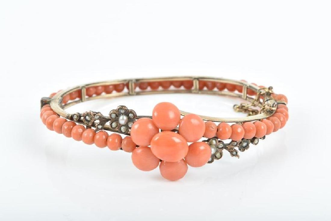 A late 19th / early 20th century coral bangle  the