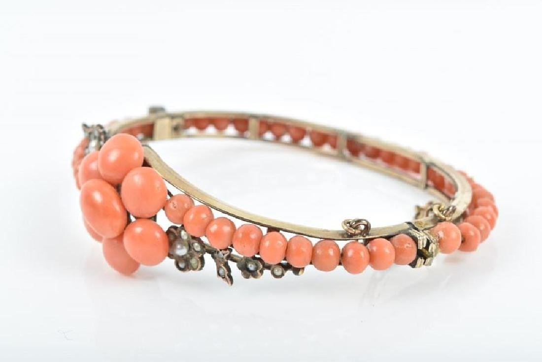 A late 19th / early 20th century coral bangle  the - 3