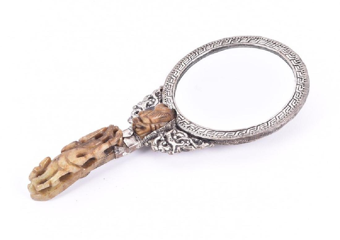 A Chinese white metal and hardstone set hand mirror