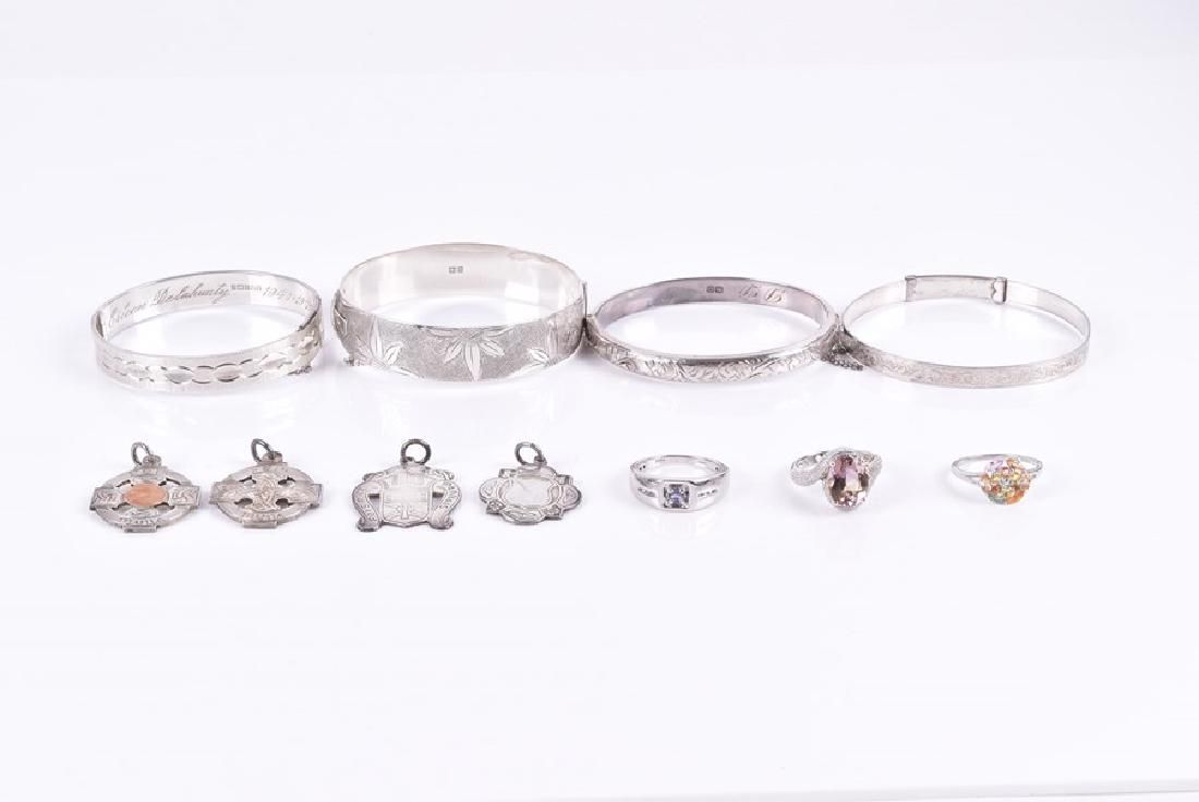 A group of silver jewellery items including four