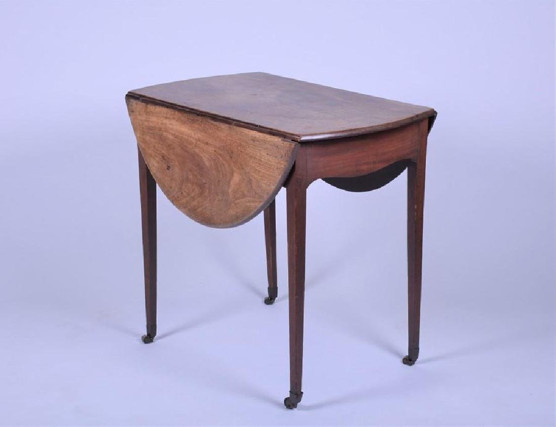 A George III mahogany Pembroke table  with fitted