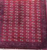 A large Persian Bokhara style rug  decorated with
