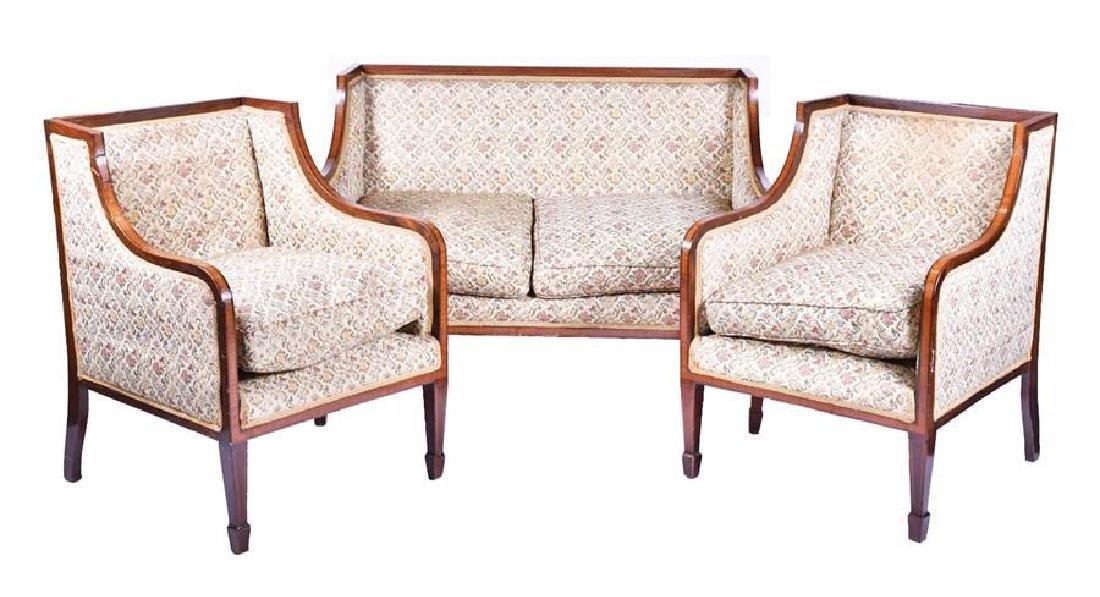 An Edwardian mahogany and kingwood two-seater sofa