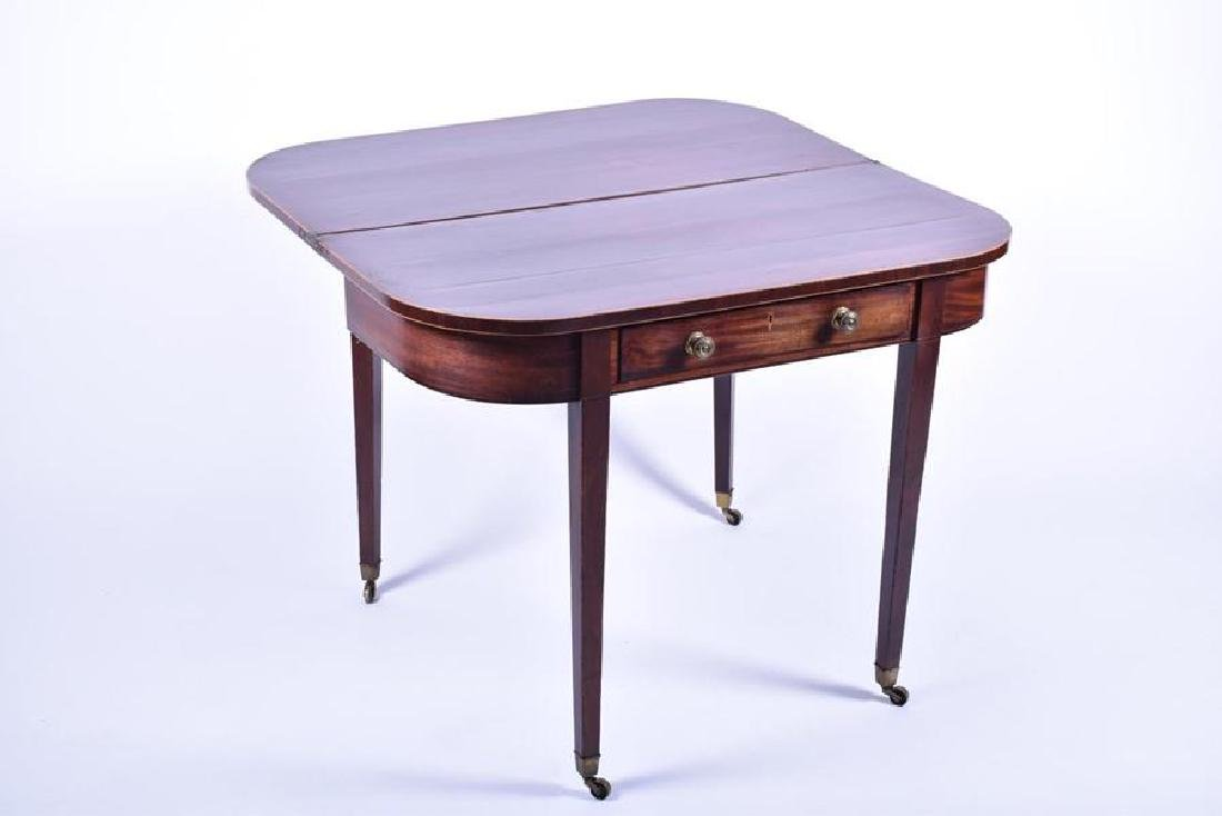 An Edwardian mahogany fold over table  with inlaid